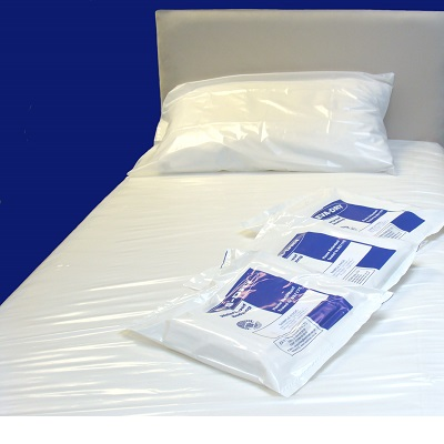 Waterproof EVA Single Mattress Cover on a bed with packaging