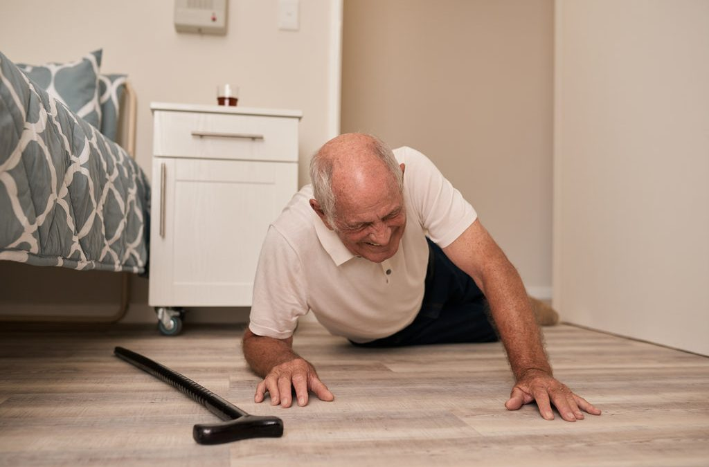 elderly man grimacing in pain after falling