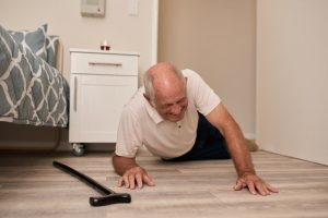 elderly man grimacing in pain after falling