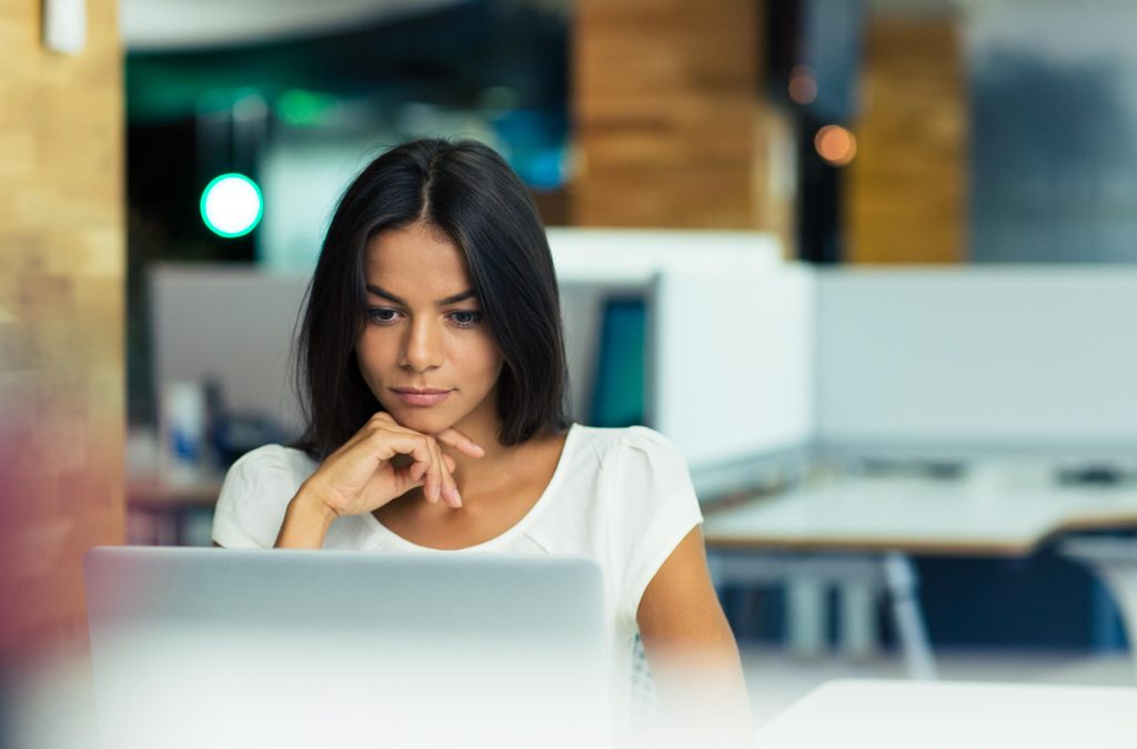 woman at a desk, managing incontinence