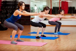 women do squats exercises for pelvic floor exercise in the gym